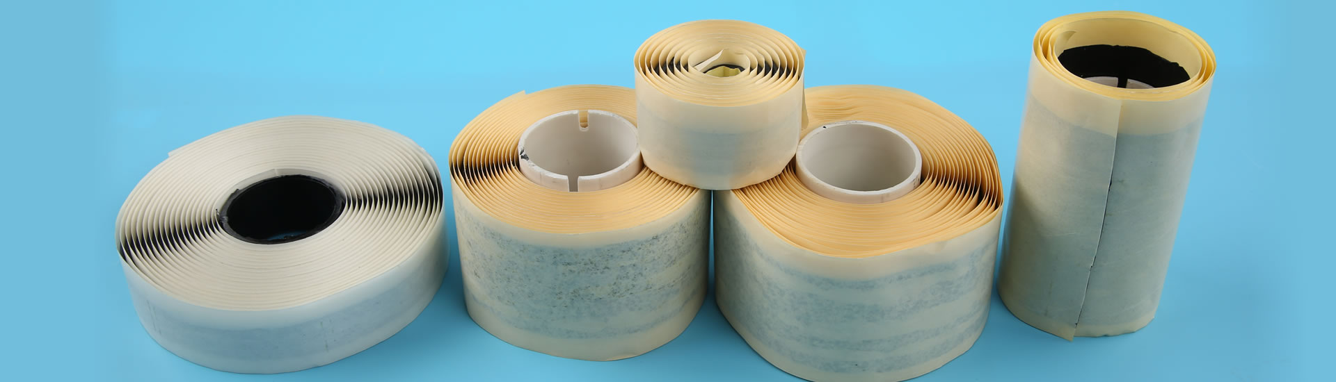 Five different types butyl tape are lying on the blue background.