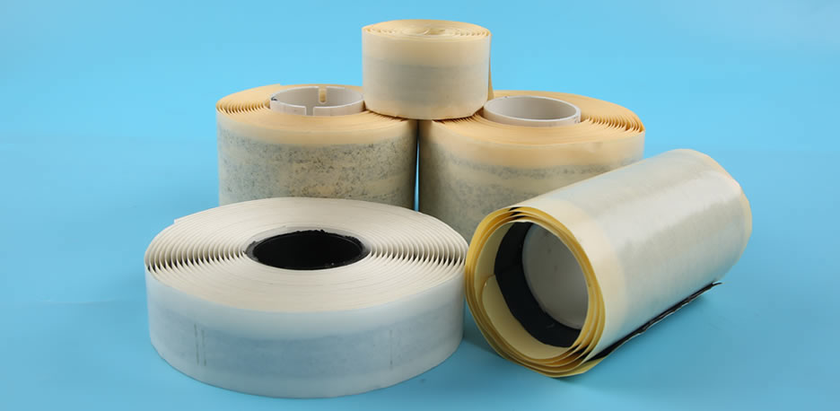 There are five different sizes butyl tape lying on the blue background.