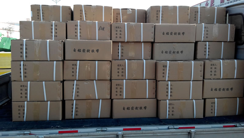 Butyl tapes that are packaged in numbers of carton boxes are put on the truck.